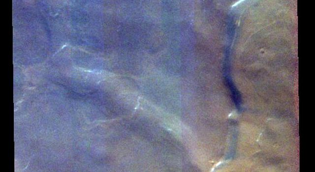 This false-color image from NASA's Mars Odyssey shows a marked difference in the 'blueness' of the ice surfaces in the north polar region of Mars. Ice/frost will appear as bright blue in color; dust mantled ice will appear in tones of red/orange.