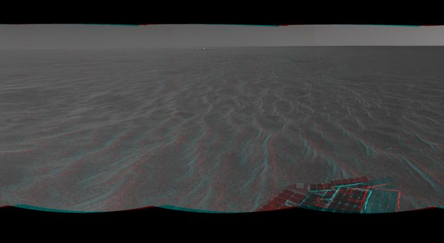 NASA's Mars Exploration Rover Opportunity was on its way from 'Endurance Crater' toward the spacecraft's jettisoned heat shield in this anaglyph. 3D glasses are necessary to view this image.