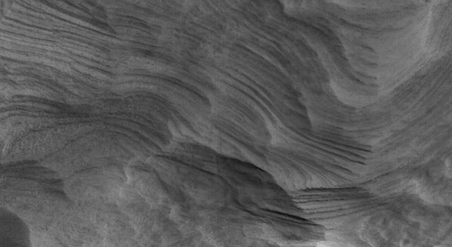 NASA's Mars Global Surveyor shows finely-layered sedimentary rock in a crater in northwestern Schiaparelli basin on Mars.