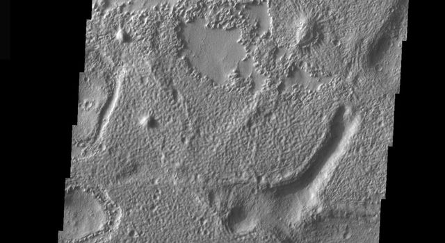 This image is part of THEMIS art month, taken by NASA's Mars Odyssey featuring a portion of Mars' landscape looking like a smile beaming down.