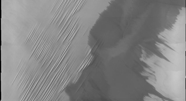 This image is part of THEMIS art month, taken by NASA's Mars Odyssey featuring a portion of Mars' landscape looking like needles in a haystack (without the haystack).