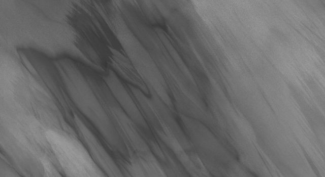 This image, part of THEMIS art month, taken by NASA's Mars Odyssey features a portion of Mars' landscape looking like a spectral vision.