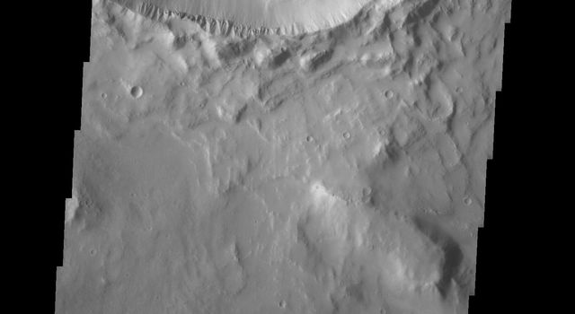 This image taken by NASA's Mars Odyssey shows a crater on Mars located in Elysium Planitia containing a well-preserved central peak, in contrast with the slumped crater walls.