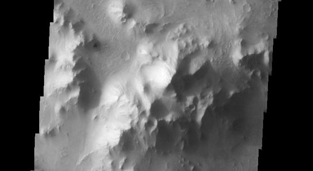 This image taken by NASA's Mars Odyssey shows a substantial central peak on the floor of a larger crater in Isidis Planitia on Mars.