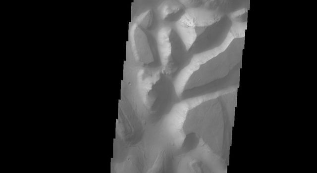 This image taken by NASA's Mars Odyssey shows Hydraotes Chaos, the large chaos terrain just east of Valles Marineris on Mars. Chaos is the blocky landscape after the transport and removal of subsurface support.