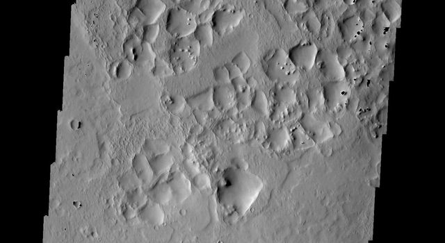 This image taken by NASA's Mars Odyssey shows the highlands northwest of Syrtis Major on Mars; polygonal ridges are evident.
