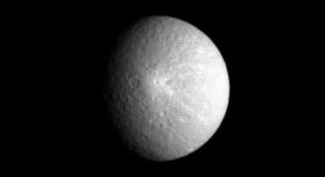 Saturn's moon Rhea displays one of its more prominent features here: a bright, rayed crater which was seen at much higher resolution in an image taken two weeks earlier by NASA's Cassini spacecraft.