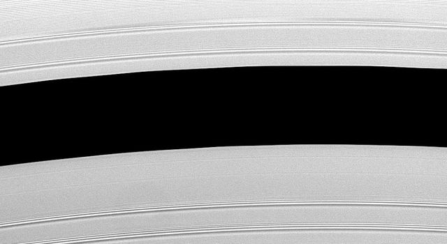 This image captured by NASA's Cassini spacecraft shows Saturn's Encke Gap (325 kilometers, or 200 miles wide) whose center is 133,590 kilometers (83,010 miles) from Saturn. This division in the rings is home to the small moon called Pan.