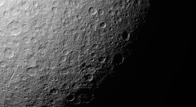 Like the rest of Rhea's surface, the southern polar region of this Saturn moon has been extensively re-worked by cratering over the eons. This image from NASA's Cassini spacecraft shows most sizeable craters have smaller, younger impact sites within them.