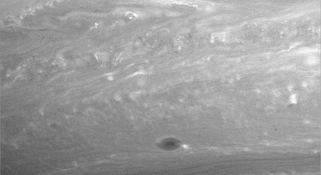 There is much to examine in close-ups of Saturn's atmosphere, like this image from NASA's Cassini spacecraft. Scientists are interested in the bright, turbulent-looking, thin boundary between the large-scale features in the upper half of image.