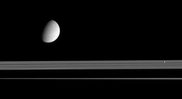 This view looks up toward the sunlit side of Saturn's rings, as Dione and Pandora trundle by. NASA's Cassini spacecraft took this image in visible light with its narrow-angle camera on Sept. 16, 2005.