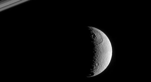 The Sun's rays strike the terrains near the terminator on Tethys at low angles, throwing features there into sharp relief. This image was taken in visible green light with NASA's Cassini narrow-angle camera on Oct. 13, 2005.