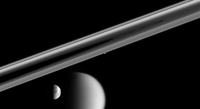 In a rare moment, NASA's Cassini spacecraft captured this enduring portrait of a near-alignment of four of Saturn's restless moons. Timing is critical when trying to capture a view of multiple bodies, like this one.