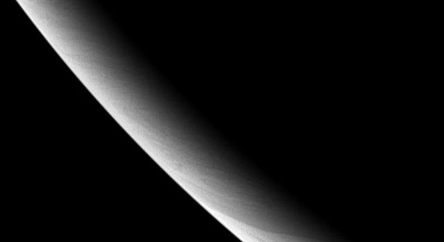 This brooding portrait from NASA's Cassini spacecraft shows the southwest limb (edge) of the cold gas giant and the thread-like cloud features lurking there.