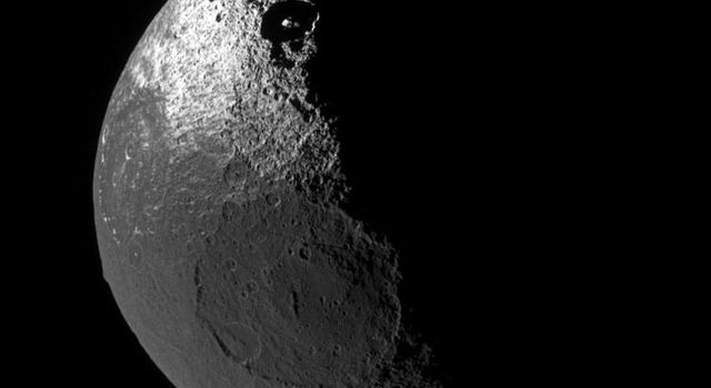 Although it is no longer uncharted land, the origin of the dark territory of Cassini Regio on Iapetus remains a mystery. The view from NASA's Cassini looks down onto the northern hemisphere of Iapetus and shows terrain on the moon's leading hemisphere.