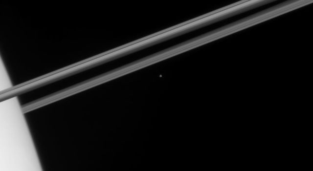 NASA's Cassini spacecraft captured this glimpse of icy Epimetheus just before the small moon disappeared behind the bulk of Saturn's atmosphere.
