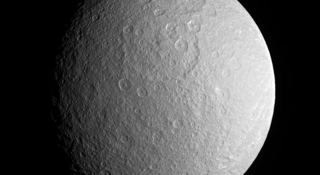 This close view of Rhea prominently shows two large impact basins on the ancient and battered moon. This image was taken with NASA's Cassini spacecraft's narrow-angle camera on Dec. 23, 2005.