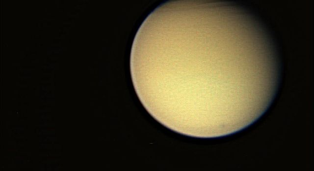 This view of Titan, captured by NASA's Cassini spacraft on Dec. 26. 2005, reveals structure in the moon's complex atmosphere.