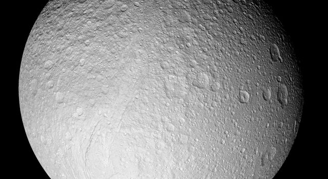 With this full-disk mosaic, NASA's Cassini presented the best view yet of the south pole of Saturn's moon Tethys, taken on Sept. 24, 2005. The giant rift Ithaca Chasma cuts across the disk.