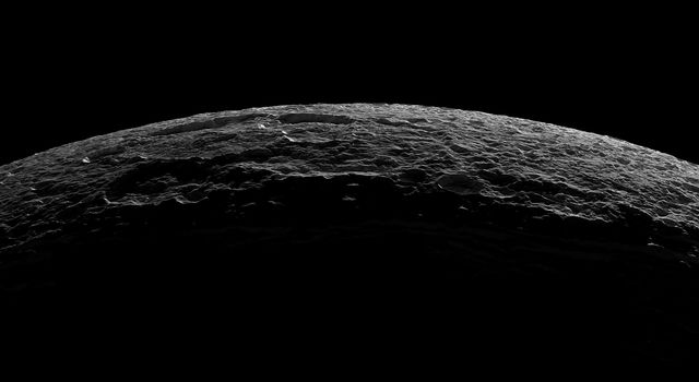As it departed its encounter with Saturn's moon Dione, NASA's Cassini spacecraft sailed above an unreal landscape blasted by impacts. The rising Sun throws craters into sharp contrast and reveals steep crater walls.