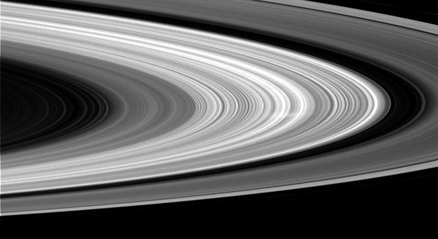 This image from NASA's Cassini spacecraft shows a ghostly white streak, called a spoke, in Saturn's B ring. This is the first sighting of a spoke in nearly a year, and the first spoke seen by Cassini on the sunlit side of the rings.