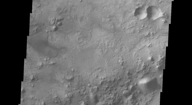 This image from NASA's Mars Odyssey spacecraft is of a small dune field inside an unnamed crater south of Nili Fossae on Mars.