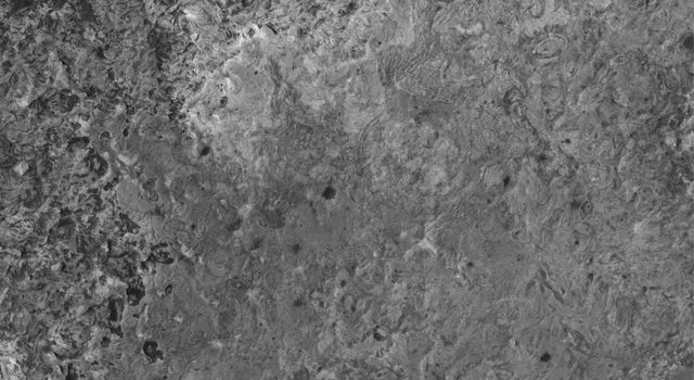 NASA's Mars Global Surveyor took this image in April, 2005, showing a high resolution view of a surface composed almost entirely of eroded, exposed sedimentary rock in the Sinus Meridiani region of Mars.