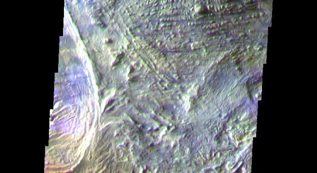 This false-color image from NASA's Mars Odyssey spacecraft shows part of the floor of Candor Chasma in central Valles Marineris, taken during Mars' southern fall season.