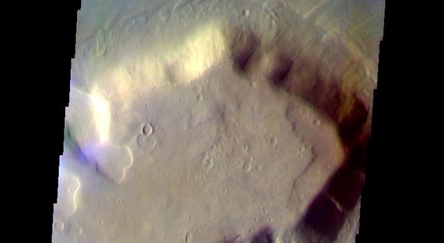This false-color image from NASA's Mars Odyssey spacecraft shows a mesa and surrounding debris apron located in the Deuteronilus Mensae region, taken during Mars' southern fall season.