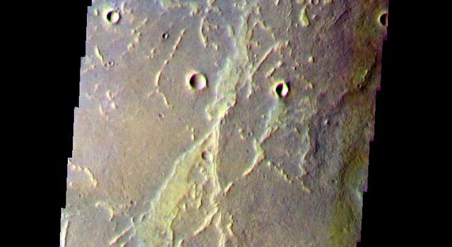 This false-color image from NASA's Mars Odyssey spacecraft shows part of the floor of Antoniadi Crater, taken during Mars' northern spring season.