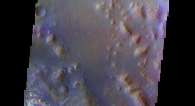 This false-color image from NASA's Mars Odyssey spacecraft shows an old channel floor and surrounding highlands located in the lower reach of Mawrth Valles on Mars.