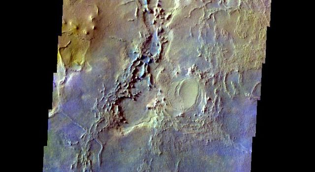 This false-color image from NASA's Mars Odyssey spacecraft shows the surface outside of Meridiani to the northeast, taken during Mars' northern spring season.