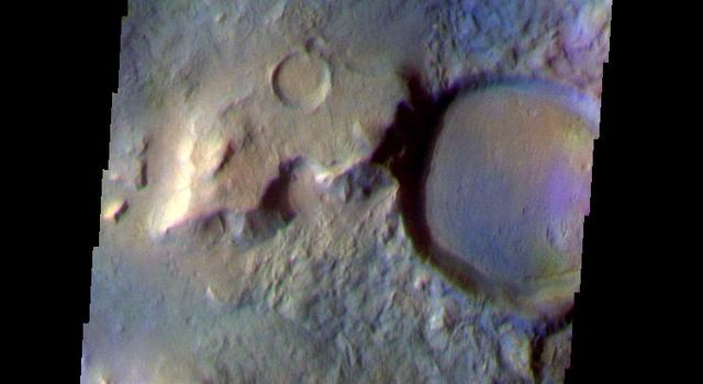 This false-color image from NASA's Mars Odyssey spacecraft shows a region with craters of different ages located at the margin of Acidalia Planitia, taken during Mars' northern spring season.