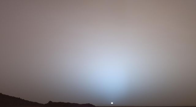 On May 19th, 2005, NASA's Mars Exploration Rover Spirit captured this stunning view as the Sun sank below the rim of Gusev crater on Mars. This Panoramic Camera (Pancam) mosaic was taken around 6:07 in the evening of  the rover's 489th martian day.