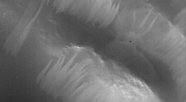 This image from NASA's Mars Global Surveyor shows a portion of the stair-stepped, north wall of a crater in Arabia Terra.