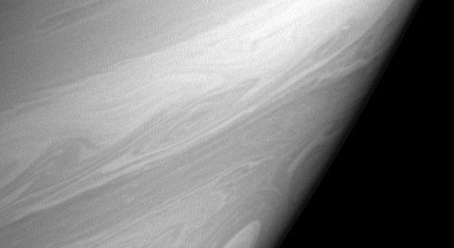 Bright, high altitude clouds, like those imaged here, often appear more filamentary or streak-like than clouds imaged at slightly deeper levels in Saturn's atmosphere. This view from NASA's Cassini also shows one of the many 'cat's eye' vortices.