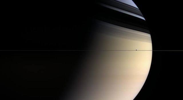 Dreamy colors ranging from pale rose to butterscotch to sapphire give this utterly inhospitable gas planet a romantic appeal. Shadows of the rings caress the northern latitudes whose blue color is presumed to be a seasonal effect as seen by NASA's Cassini