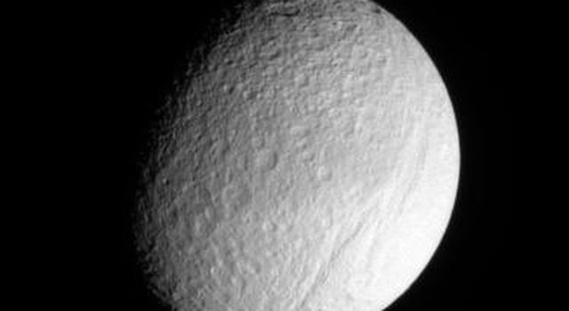 Ithaca Chasma rips across the cratered surface of Tethys, creating a scar more than 1,000 kilometers (600 miles) long, from north to south. NASA's Cassini spacecraft got a closer look at this ancient rift during a Sept. 2005 flyby of Tethys.