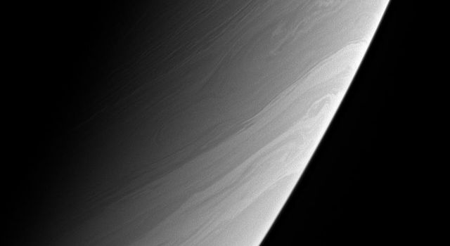 The long, gently meandering character of the clouds in this view from NASA's Cassini spacecraft is a tracer of the generally stable flow of Saturn's atmosphere.