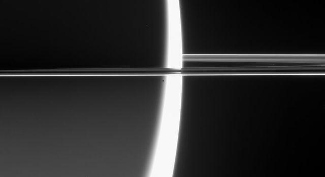 NASA's Cassini spacecraft captured this arresting view of Saturn just before Epimetheus crossed into the blinding glare of the planet's sunlit crescent and was lost.