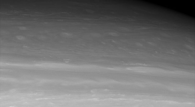 This infrared view from NASA's Cassini looks toward middle to high northern latitudes on Saturn, revealing entrancing meanders in the clouds. The cloud patterns transition from puffier looking in the south to smoother oval shapes in the north
