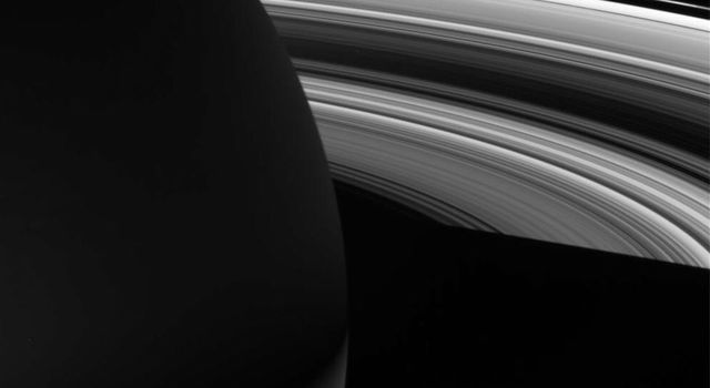 The night skies of Saturn are graced by the planet's dazzling rings in this view from NASA's Cassini spacecraft.