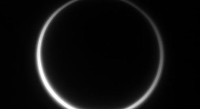 Titan's murky atmosphere shines as a halo of scattered light in this image taken by NASA's Cassini spacecraft on Aug. 10, 2006.