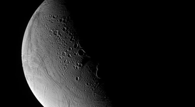 Sturn's moon Enceladus has enchanted scientists and non-scientists alike. With its potential for near-surface liquid water, the icy moon may be a possible abode for life. This image was captured by NASA's Cassini spacecraft.