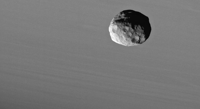 NASA's Cassini spacecraft provides this dramatic portrait of Janus against the cloud-streaked backdrop of Saturn.