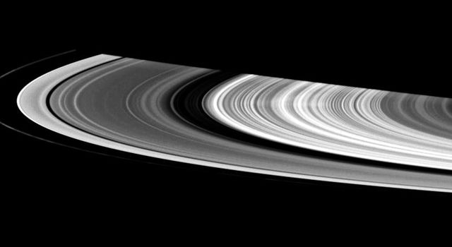 This contrast-enhanced view shows a faint spoke in Saturn's B ring. These ghostly radial structures were imaged by NASA's Voyager spacecraft in the 1980s.