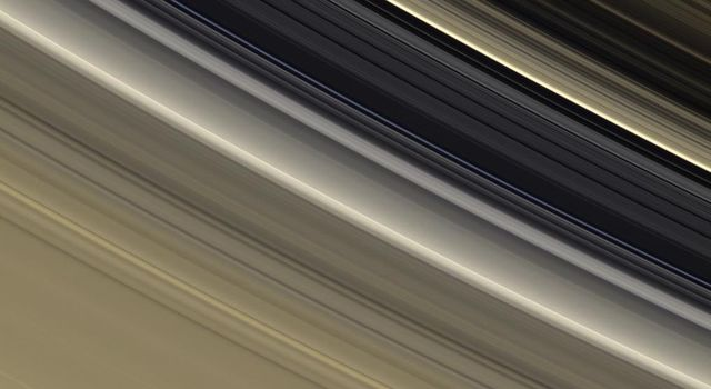 The rings are awash in subtle tones of gold and cream in this view from NASA's Cassini spacecraft which shows the outer B ring, the Cassini Division and the inner part of the A ring.