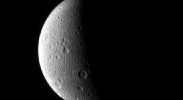 Dione looks lovely half lit in this portrait from NASA's Cassini spacecraft. Just visible is a long canyon running southward just left of the terminator in this image captured by NASA's Cassini spacecraft on Oct. 29, 2006.
