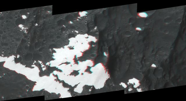 This anaglyph, shows huge mountains on Saturn's moon Iapetus, imaged by NASA's Cassini spacecraft during its very close flyby in Sept. 2007. 3D glasses are necessary to view this image.