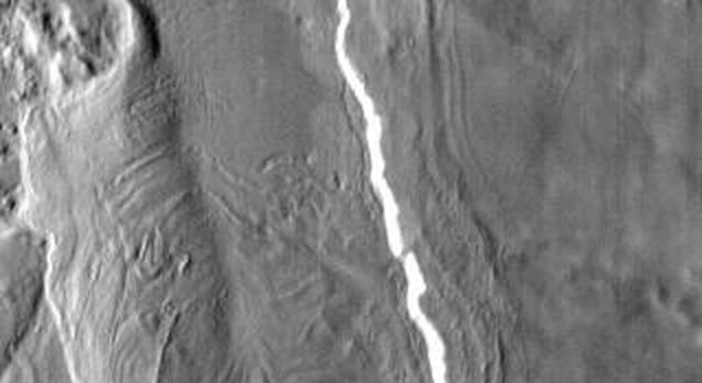 This vent and associated flow are located at the base of Arsia Mons on Mars as seen by NASA's 2001 Mars Odyssey spacecraft.